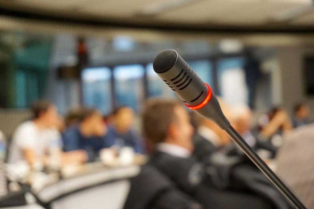 nutrition speaker, nutrition seminar, motivational speaker, webinar: close up of microphone in a conference room