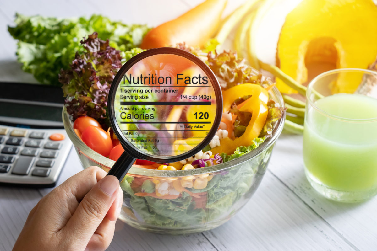 Nutritionist Toronto and Dietitian Toronto: magnifying glass held over a salad bowl on table