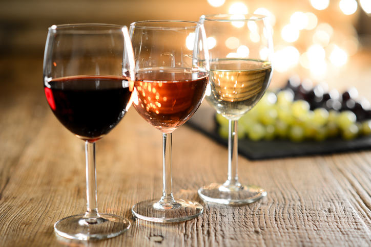 Wine and Weight Loss: three glasses of wine on table, grapes in background