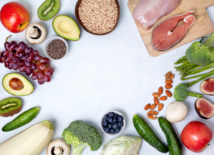 holistic nutritionist: table full of vegetables, fruit, meats, nuts and seeds