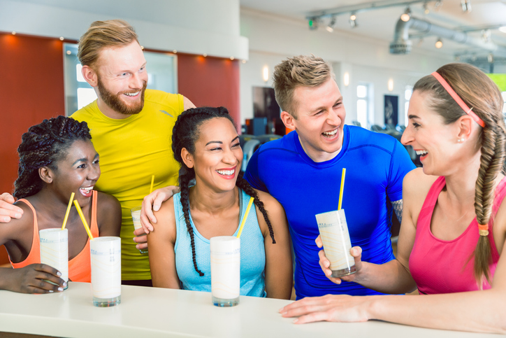 meal plans for athletes: a group of athletes socializing over a protein shake
