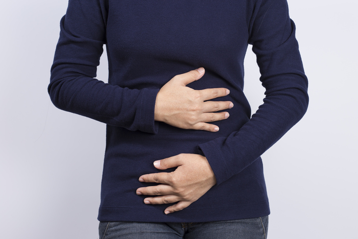 Digestive health woman in stomach pain from SIBO