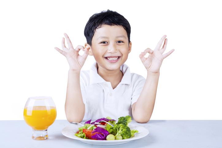 boy enjoying food on a healthy meal plan for kids